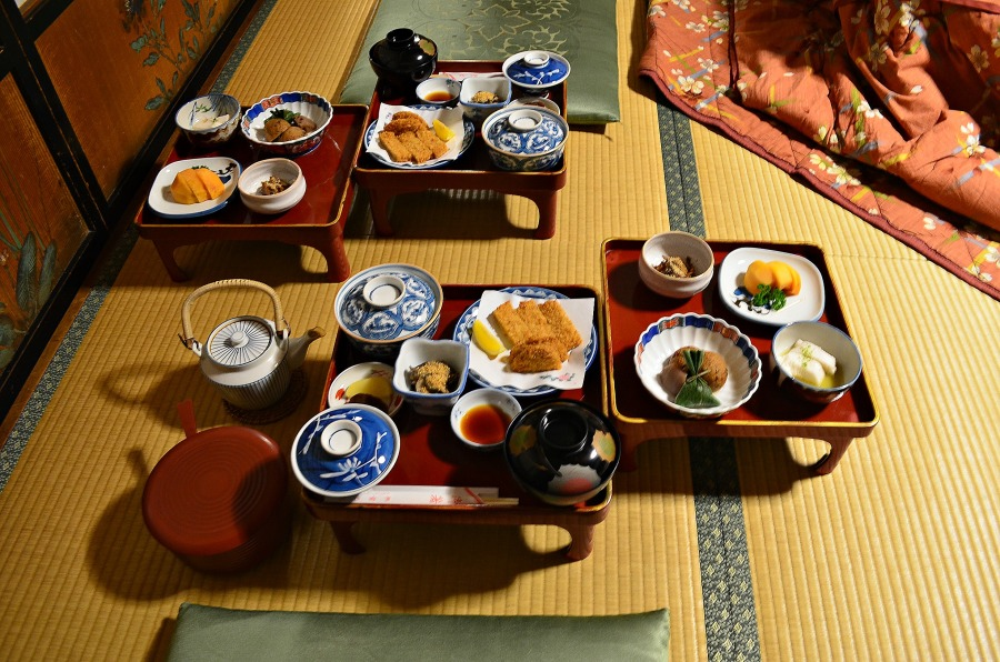 Japanese bento laid out on lacquer ware, upon tatmi mats in a Japanese guesthouse.