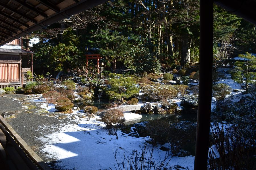 Japanese garden blanketed with snow